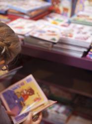 Livre Paris - Salon du Livre de Paris : photo d'ambiance enfant en train de lire